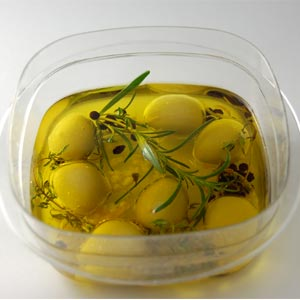 Spherical Olives macerated in aromatized oil