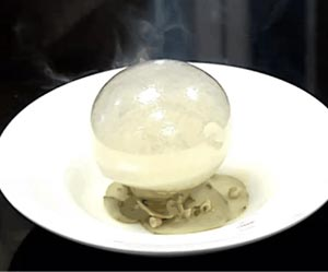 Isomalt Balloon filled with smoke on mushroom ice cream