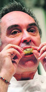 Ferran eating caviaroli cracker