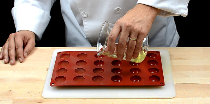 Spherification: Tomato water spheres silicone mold -filling